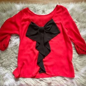 Tops - Red boutique top with black bow back